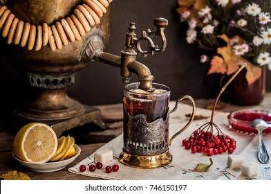 Russian Tea from Samovar, A Glass in Glass Holder, Black Tea with Viburnum Berries