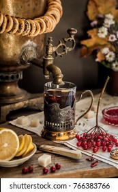 Russian Tea from Samovar, A Glass in Glass Holder, Black Tea with Viburnum Berries, copy space for your text