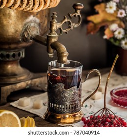 Russian Tea from Samovar, A Glass in Glass Holder, Black Tea with Viburnum Berries, square