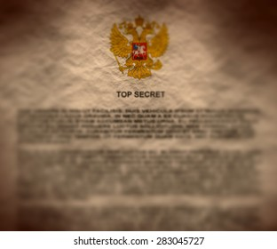 russian top secret document crumpled paper textured with russia coat of arms