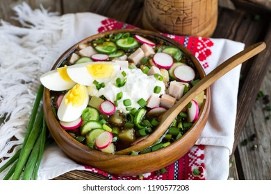 Russian traditional cold soup okroshka with potato, ham, cucmebers, eggs, radish, spring onion and kvass.