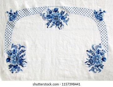 Russian traditional craft. Embroidery with blue thread on white linen.