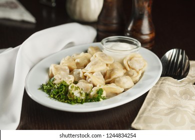 Russian traditional food - dumplings, served in restaurant