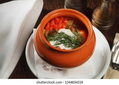 Russian traditional food - vegetable soup served in pot