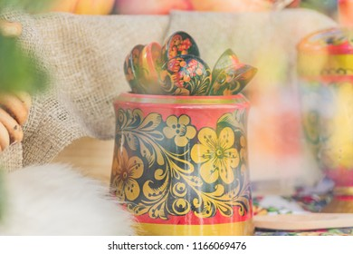 Russian traditional hohloma spoons on the table, still life, soft focus