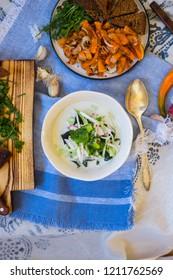 Russian traditional okroshka - a cold soup made from cucumber, kvass, radish, dill, parsley. Vegan raw okroshka with coconut milk yoghurt, lemon, garlic. Vegetarian lunch or dinner. Healthy food.