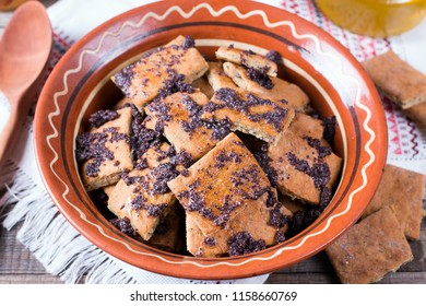 Russian traditional pastries. Cookies with poppy seeds and honey in a ceramic bowl
