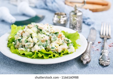 Russian traditional salad Olivier in a bowl, fresh salad