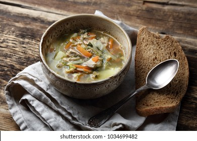 """Russian traditional soup """"Stchi"""" with cabbage, potatoes, onions, carrots, chicken, garlic and dill"""