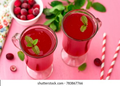 Russian traditional sweet drink kissel with cranberries and mint