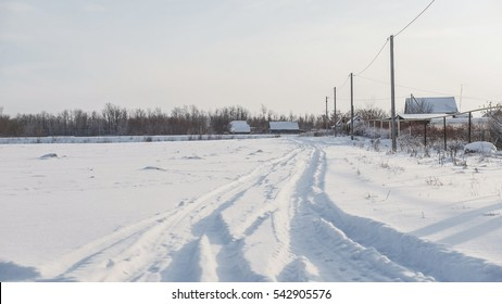 Russian village - snow-covered winter road at sunny day, wide angle