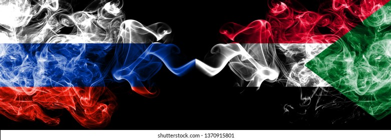 Russian vs Sudan, Sudanese smoke flags placed side by side. Thick colored silky smoke flags of Russia and Sudan, Sudanese