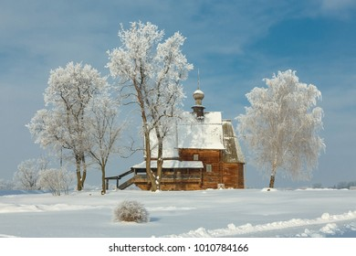 Russian winter landscape in Suzdal. Wooden Orthodox church of St. Nicholas in the Suzdal Kremlin on a frosty winter day.