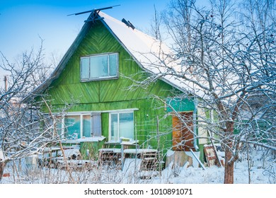 russian winter, old wooden house