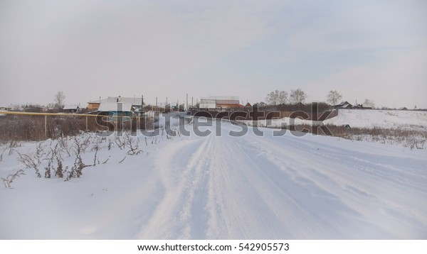 Russian winter village - countryside in center of Volga, snow cold day, wide angle