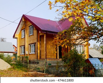 Russian wooden house with red gable roof