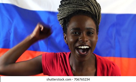 Russian Young Black Woman Celebrating with Russia Flag