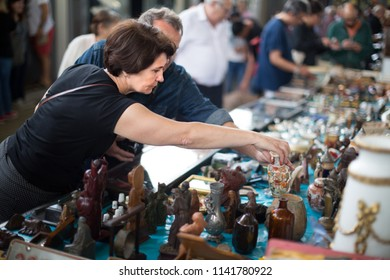 Russians  man and woman aged consider things in flea market