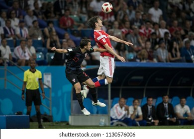 "Russia's Mario Fernandes and Croatia's Josip Pivarić fight for the ball in the air. Match Russia-Croatia at World Cup 2018. ""Fisht Stadium"", Sochi. 7th of July 2018"