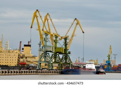 Russia.Saint-Petersburg.The seaport is working on loading ships.The round the clock work.