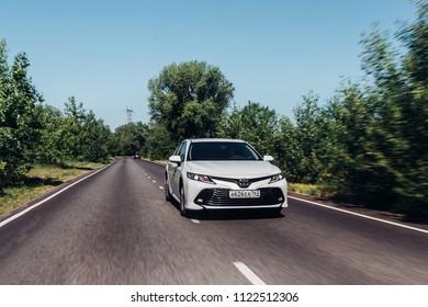 Russia-Samara, 28-06-2018 - Brand new white Toyota camry 2018 speeding fast