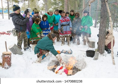 "Russkinskaya village, Khanty-Mansiysk Autonomous Okrug / Russia - 03.21-24.2016: The traditional ritual celebration of the Eastern Khanty ""The Bear games». Shaman throws gifts into the sacred fire."
