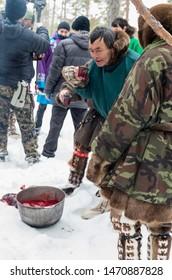 "Russkinskaya village, Khanty-Mansiysk Autonomous Okrug / Russia - 03.21-24.2016: The traditional ritual celebration of the Eastern Khanty ""The Bear games». The shaman drinks the blood of reindeer."