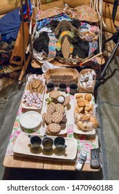 """Russkinskaya village, Khanty-Mansiysk Autonomous Okrug / Russia - 03.21-24.2016: The traditional ritual celebration of the Eastern Khanty """"The Bear games». The ritual head of a bear with the gifts."""