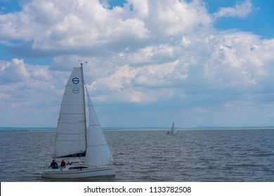 Rust, Austria - June 26 2018: Smooth sailing in Lake Neusiedl.