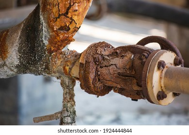 Rust damage paint and corrosion flange and bolt nut on pipeline valve drain industrial.