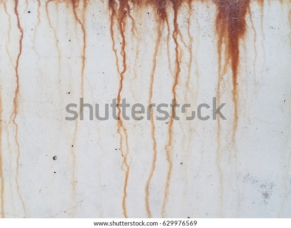 rust dripping down cement wall