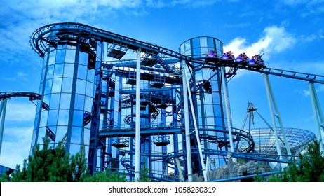 Rust, Germany - July 19, 2015: Guests at Europa-Park enjoy the Euro-Mir spinning roller coaster.