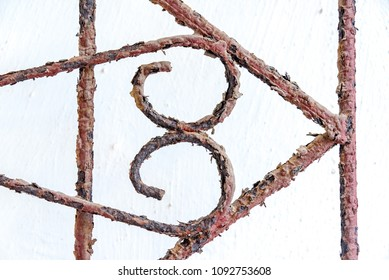 Rust: Old metal rusty door guard. Thefts and robberies are two of the most comon criminal offences commited so most people own guards for windows and doors