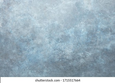 Rust and oxidized metal background. Old metal iron panel. Vintage abstract background with dim gray and blue, colors and space for text or image. Old distressed blue grungy wall background