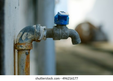 rust pipe faucet used long ago