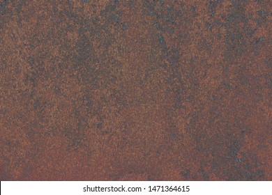 rust plate with black structure close up wallpaper