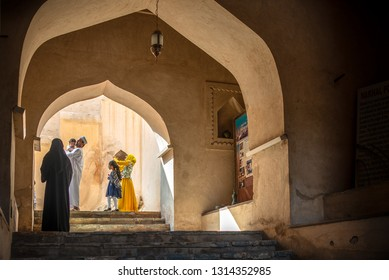 RUSTAQ, OMAN - NOVEMBER 27, 2018: Omani family visiting Rustaq Fort, Sultanate of Oman