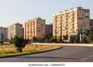 Rustavi city, Georgia. 20 september of 2018. Curved asphalt road on the background of multi-storey buildings.