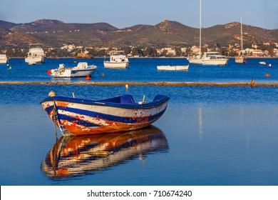Rusted boat in the bay. Glyfada. South Attica, Greece.