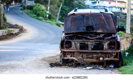 Rusted car on roadside