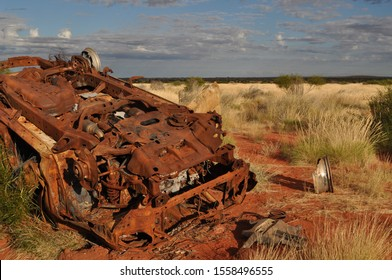 Rusted car wreck in the afternoon sun on the Canning Stock Route Western Australia, a victim of the harsh road conditions
