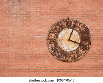 Rusted clock on wall