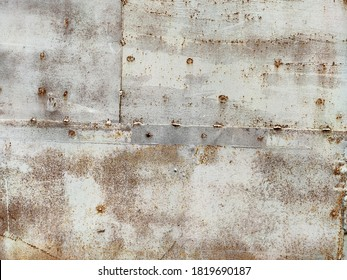 Rusted colorful painted metal wall. Rusty metal background with streaks of rust. Corroded metal background. Rust stains. The metal surface rusted spots. Rystycorrosion.