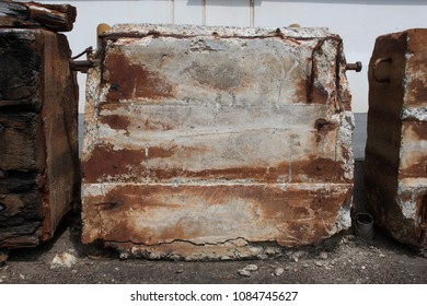 A rusted concrete block counterweight