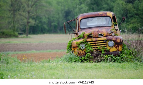 Rusted Farm Truck In Field