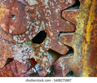 Rusted gears and metal Logging equipment junkyard