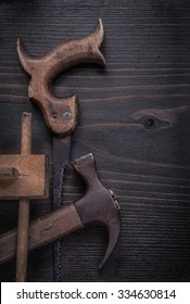 Rusted hand saw vintage marking gauge claw hammer vertical image.