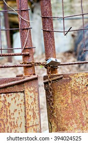 Rusted lock on old gate