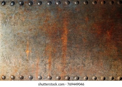 Rusted metal plate with rivets