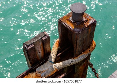 A rusted mooring point and rope on the beachport jetty in beachport south australia on november 9th